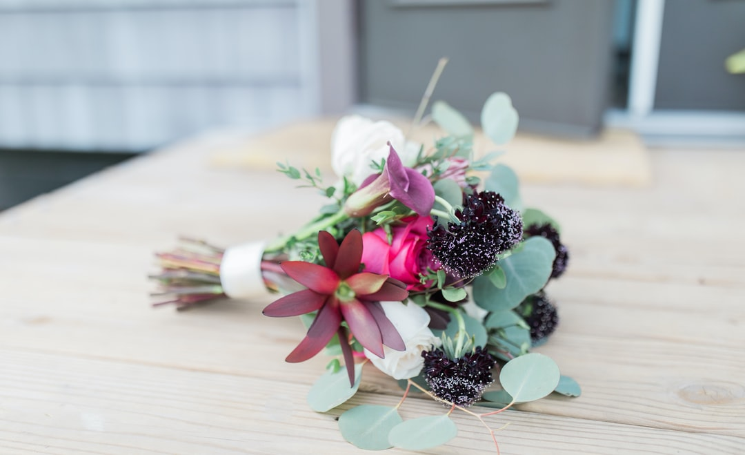 A bouquet of flowers is sitting on a table